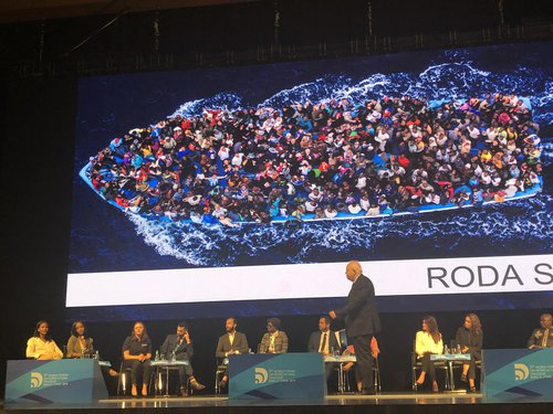 Baku Forum 2019, panelists with boat. By Heaven Crawley. Used with permission.