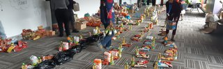 Volunteers in Philippi, Cape Town packing COVID food parcels_Photo_Discott_CCBYSA.jpg