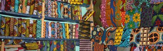 Waxprints_in_a_West_African_Shop_Photo_Alexander_Sarlay_CCBYSA.jpg