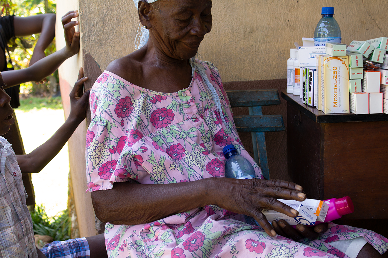 Woman receiving medication in rural Haiti.png